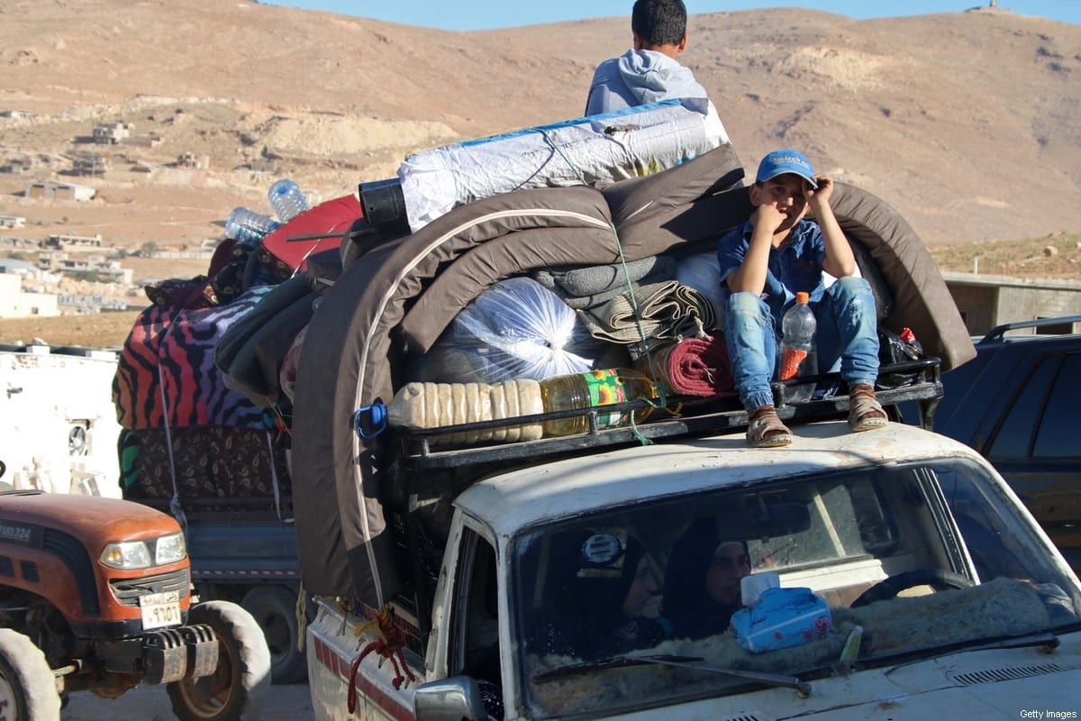 Syrians prepare to leave their refugee camp in Lebanon on 7 July 2018 [AFP/Getty Images]