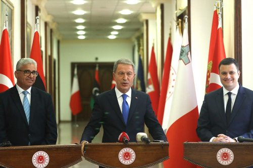 Turkish Defense Minister Hulusi Akar (C) Libyan Interior Affairs Minister Fethi Basaga (L) and Maltese National Security and Home Affairs Minister Byron Camilleri (R) following their tripartite meeting for Libya in Ankara, Turkey on 20 July 2020 [Arif Akdoğan/Anadolu Agency]