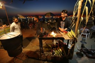 Palestinians enjoy an evening out on the seaside promenade in Gaza, 21 July 2020 [Mohammed Asad/Middle East Monitor]
