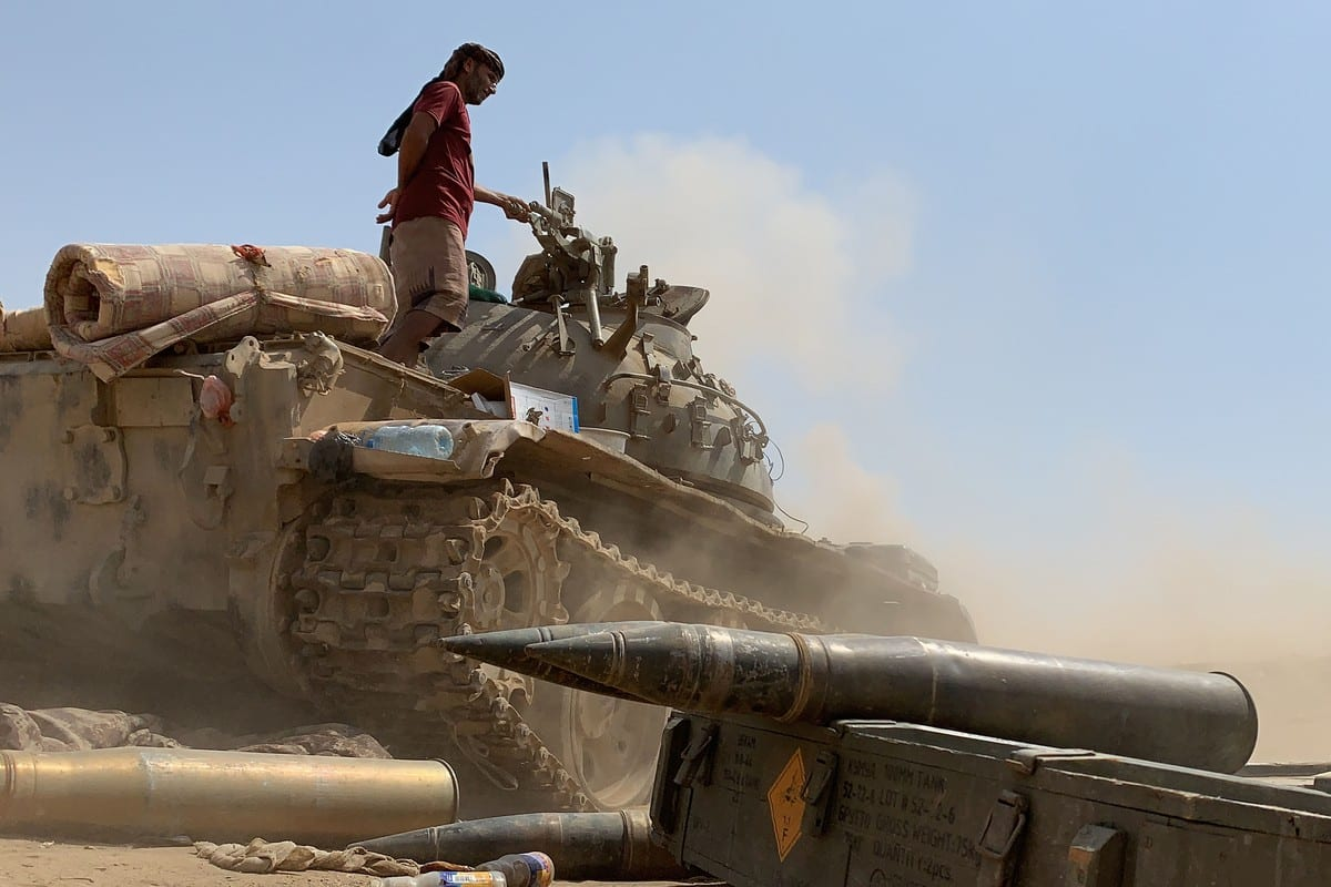 A fighter loyal to Yemen's separatist Southern Transitional Council (STC) stands atop a tank in Yemen on 23 May 2020 [NABIL HASAN/AFP/Getty Images]
