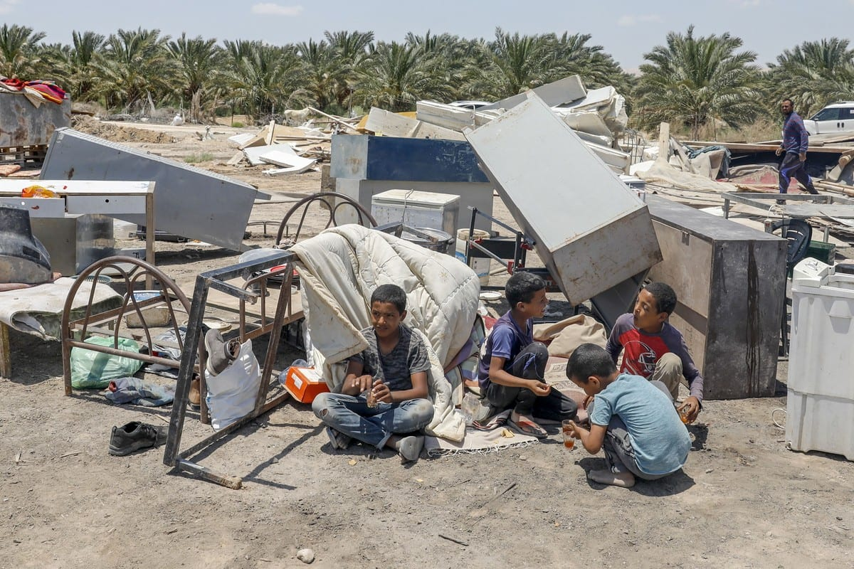 Palestinian boys sit near rubble after Israeli authorities demolished their house in the West Bank on 3 June 2020 [AHMAD GHARABLI/AFP/Getty Images]