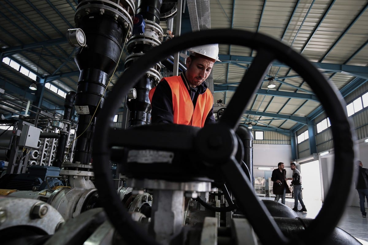 An employee at a water desalination plant on 19 January 2017 [SAID KHATIB/AFP/Getty Images]