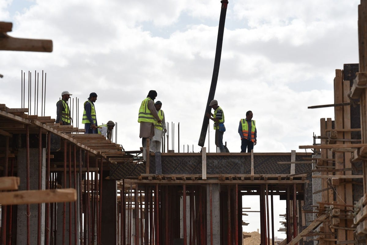 Foreign labourers work on the construction of a house in the Saudi capital Riyadh on 13 April 2019 [FAYEZ NURELDINE/AFP/Getty Images]