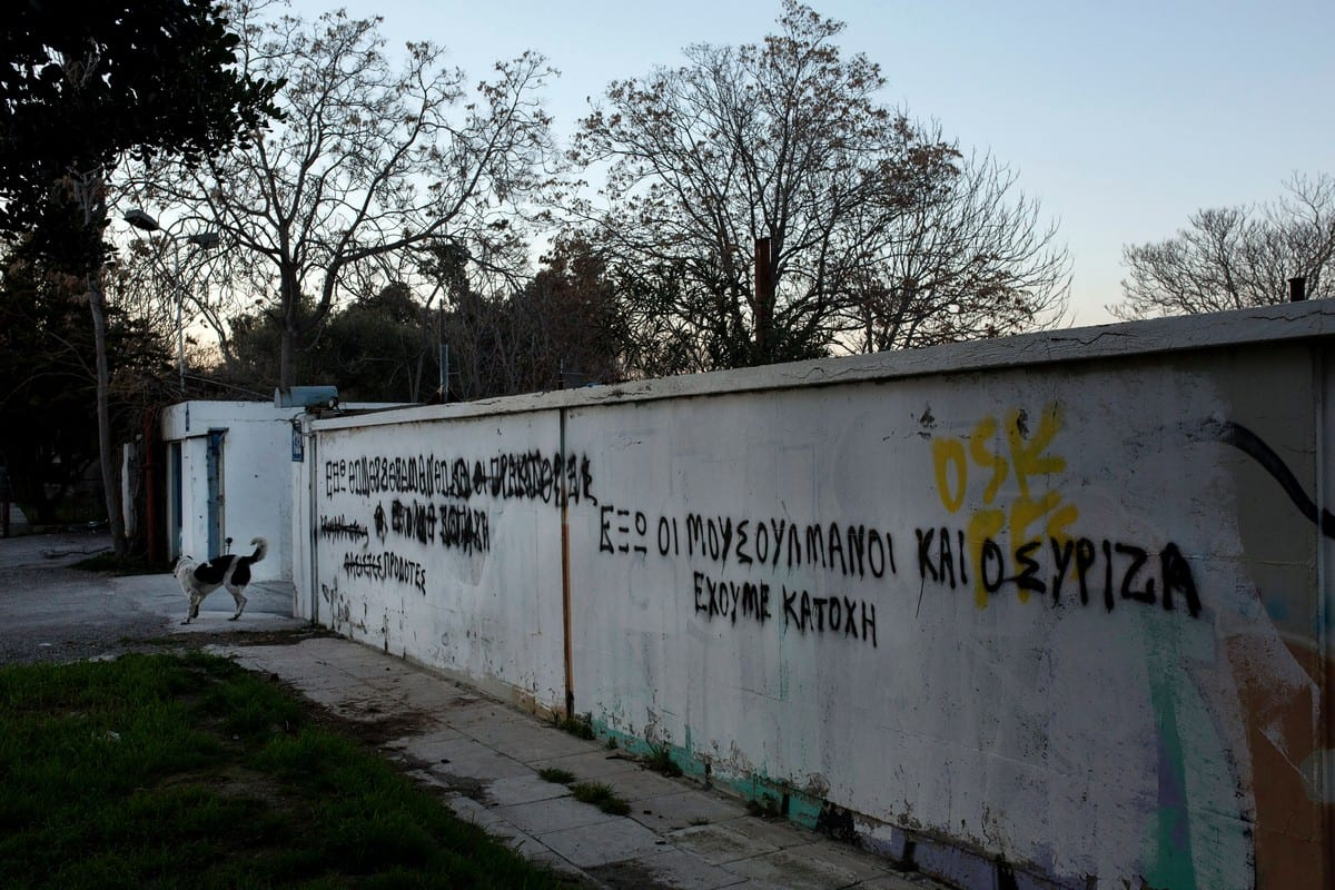 A slogan reading 'Muslims out' on a wall next old naval base where the construction of the first mosque has started in Athens, Greece on 22 February 2017 [ANGELOS TZORTZINIS/AFP/Getty Images]