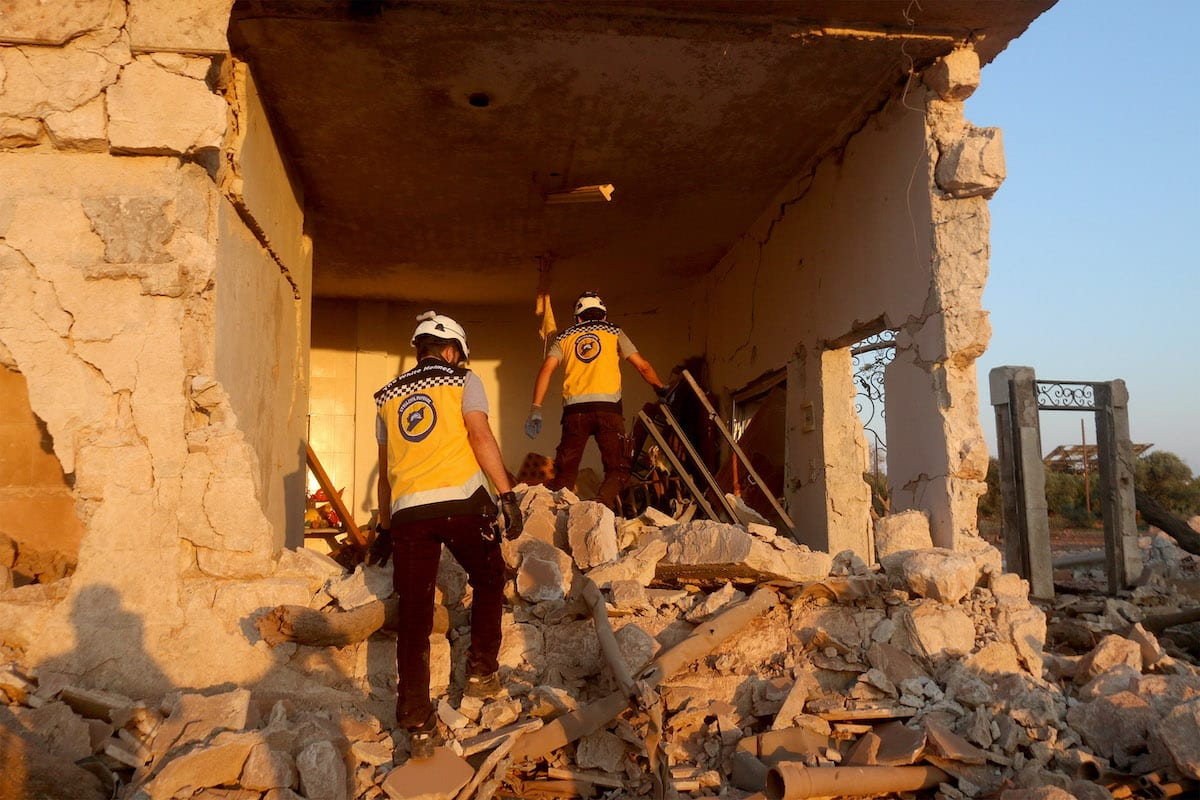 Civil defence workers conduct a search and rescue operation at the site after war planes belonging to Assad Regime and Russia carried out airstrikes in Binnish town, northwestern Syria's Idlib on 3 August, 2020 [Asaad Al Asaad/Anadolu Agency]