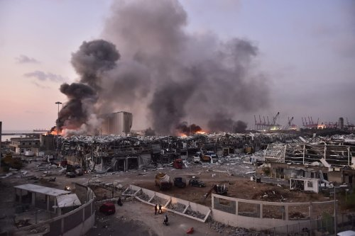 Smoke rises after a fire at a warehouse with explosives at the Port of Beirut led to massive blasts in Beirut, Lebanon on 4 August 2020 [Houssam Shbaro/Anadolu Agency]