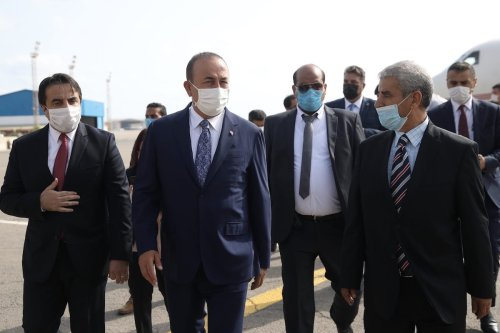 Turkish Foreign Minister Mevlut Cavusoglu (left 2) is welcomed at the airport upon his arrival in Tripoli, Libya on 6 August 2020. [Fatih Aktaş - Anadolu Agency]