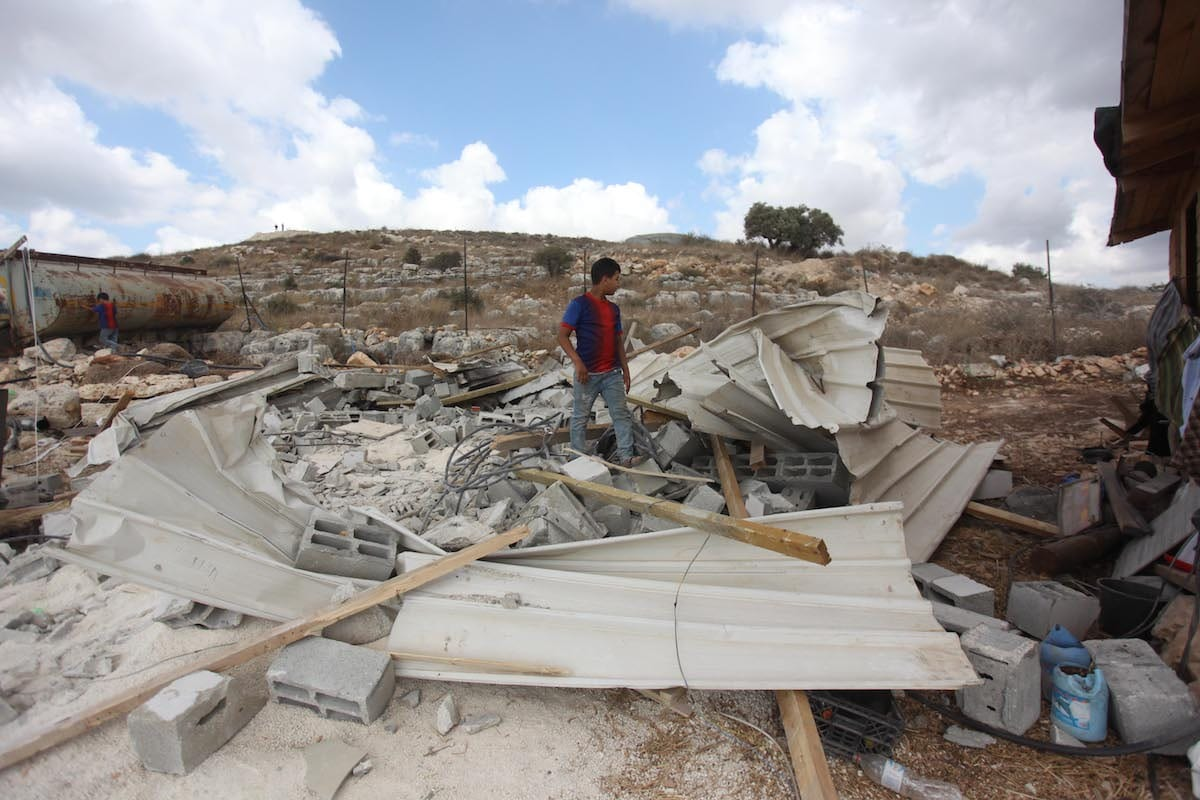 The debris of a building is seen after Israeli security forces demolished a house belonging to Palestinian Amarne family and a water storage tank with a capacity of 250 cubic meters due to allegedly unlicensed construction in the Ferrasin town of Jenin, West Bank on 10 August 2020. [Nedal Eshtayah - Anadolu Agency]