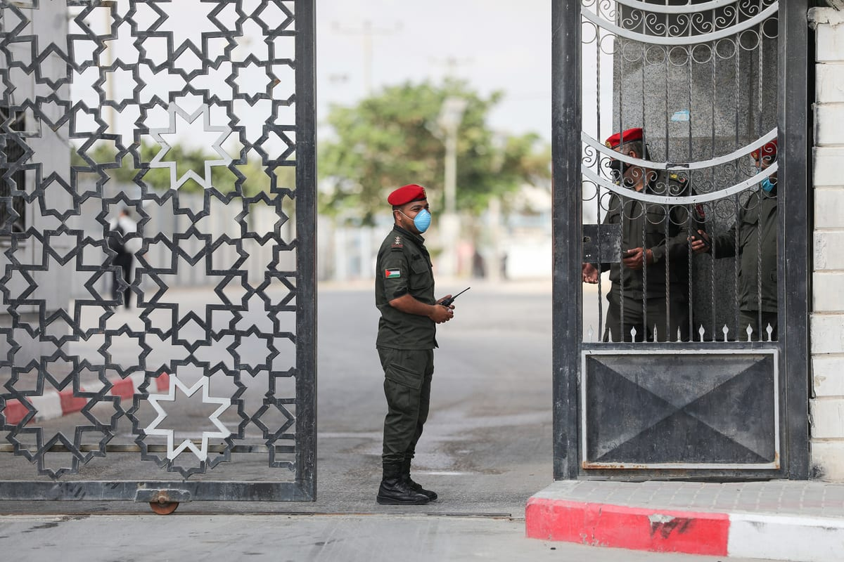 Guards seen at the Gaza-Egypt border's Rafah crossing, in Rafah, Gaza on August 11, 2020 [Mustafa Hassona / Anadolu Agency]