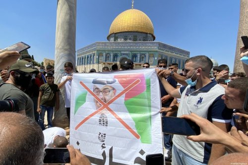 A group of Palestinians protest against United Arab Emirates and Crown Prince of Abu Dhabi, Mohammed bin Zayed in East Jerusalem's Old City on August 14, 2020 [Stringer/Anadolu Agency]