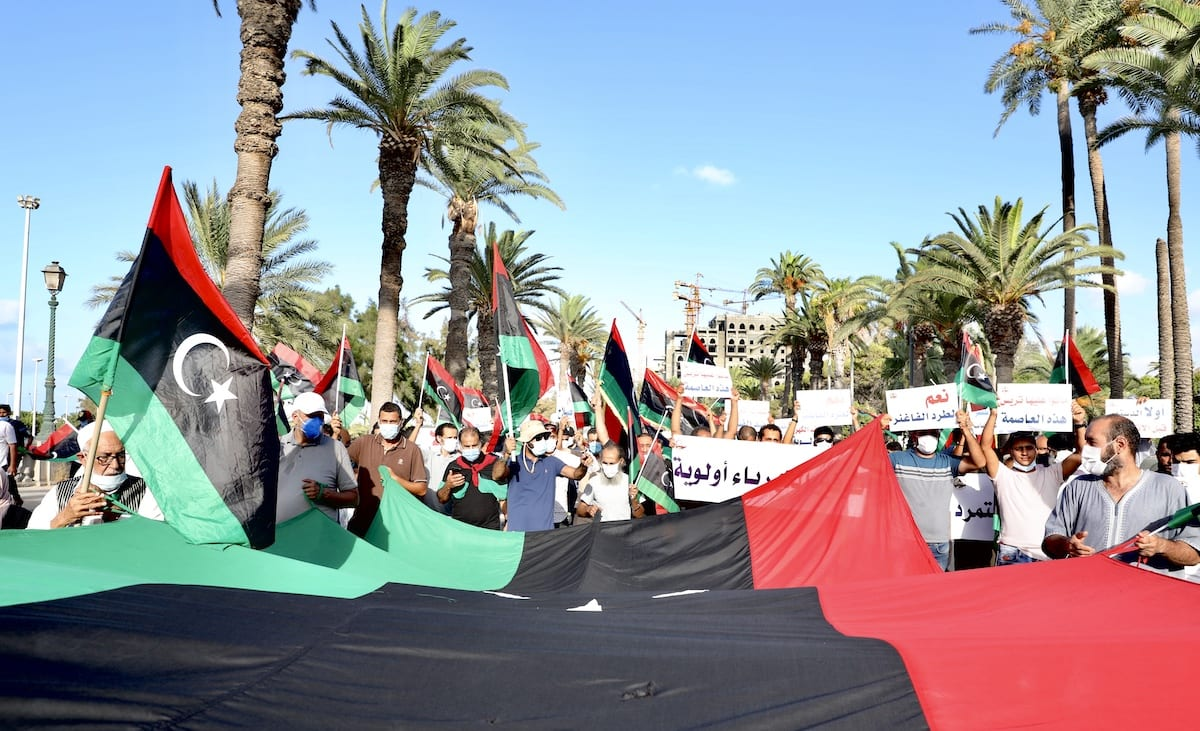 Hundreds of people gather at Martyr's Square during a demonstration to protest against hard living conditions and the leader of the illegitimate armed forces Khalifa Haftar's oil blockage, on 25 August 2020 in Tripoli, Libya. [Hazem Turkia - Anadolu Agency]