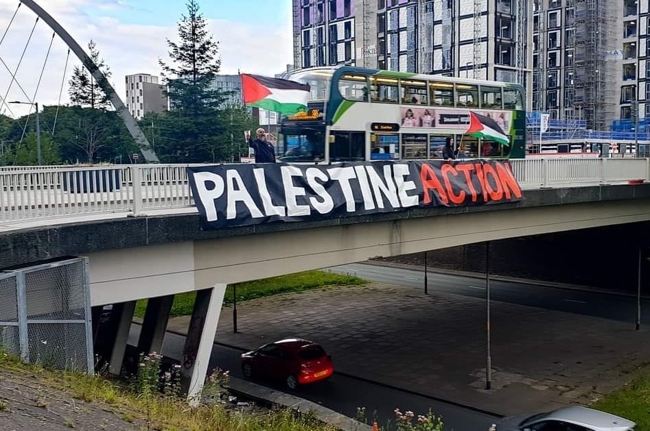 Palestine Action drop a banner from a bridge