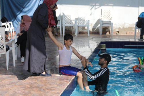 The second swimming and water games camp for children with autism in Gaza, on 25 August 2020 [Mohammed Asad/Middle East Monitor]