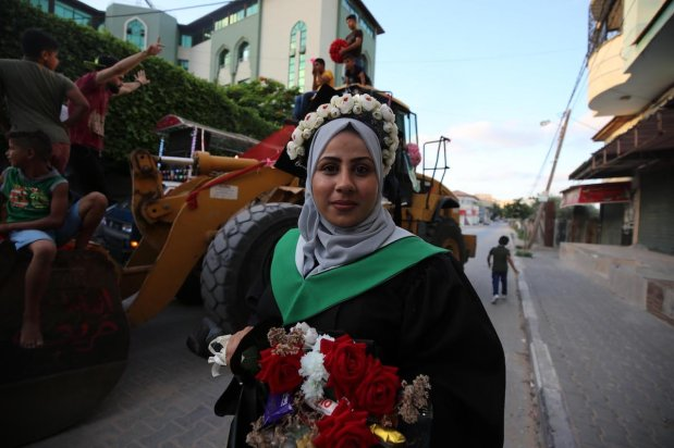 Intisar Al-Batsh graduated from the University College of Applied Sciences in Gaza City with a degree in journalism and media studies on 10 August 2020 [Mohammed Asad/Middle East Monitor]