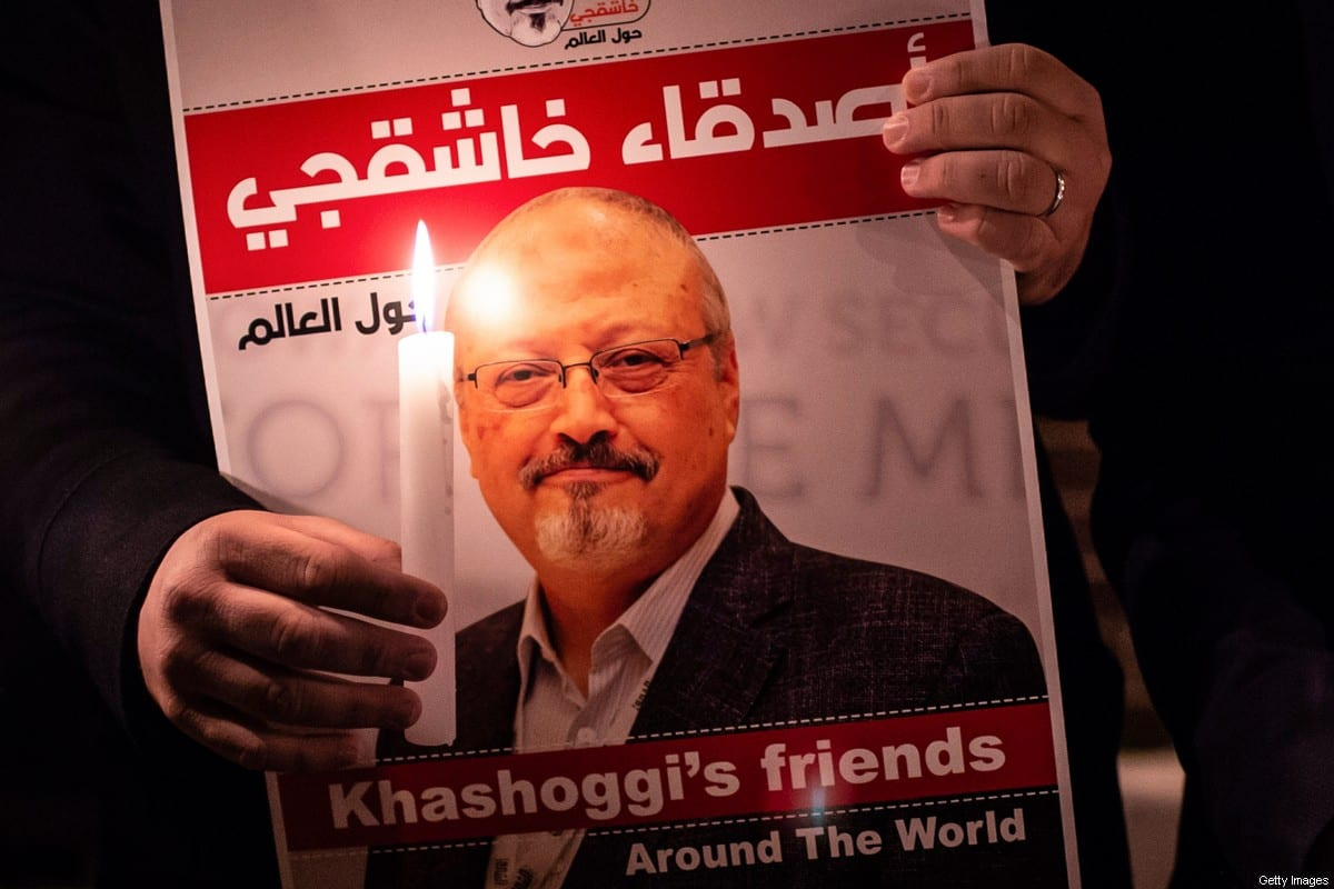 A demonstrator holds a poster picturing Saudi journalist Jamal Khashoggi on October 25, 2018 [YASIN AKGUL/AFP via Getty Images]
