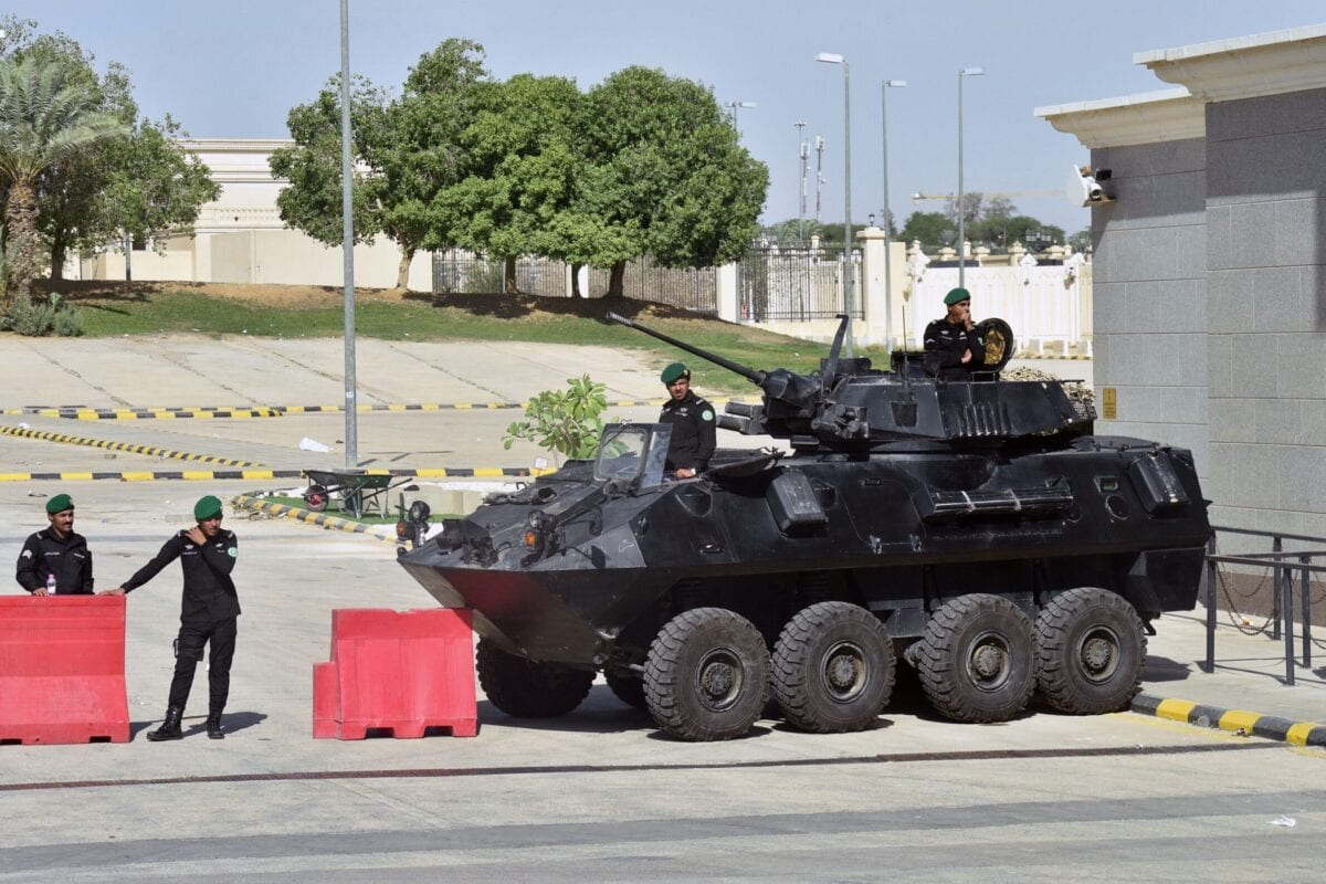 Saudi soldiers in armoured vehicles guard the entrance to the Diriya Palace in the Saudi capital Riyadh during the Gulf Cooperation Council (GCC) summit on December 9, 2018 [FAYEZ NURELDINE/AFP via Getty Images]