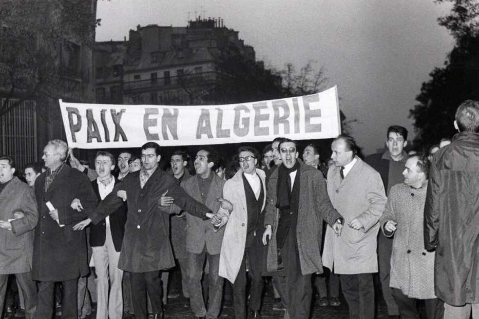 Demonstrators shout slogans in favor of independence and peace in Algeria on the Grands Boulevards in Paris on November 18, 1961, during one of the French demonstrations opposed to the Algerian war [- / AFP via Getty Images]