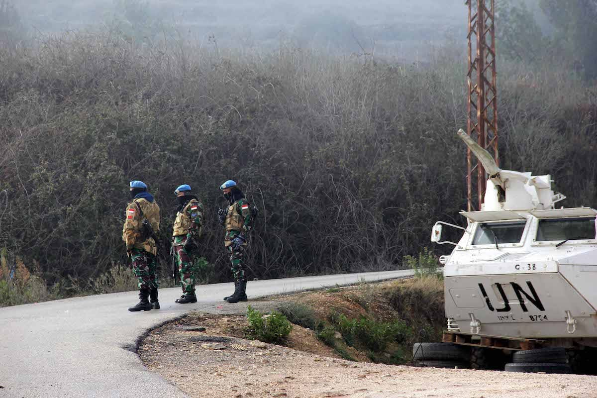 A United Nations Interim Forces in Lebanon (UNIFIL) armoured vehicle is parked on a side road in the southern Lebanese town of Kfar Kila near the border with Israel on 3 January 2020. [ALI DIA/AFP via Getty Images]