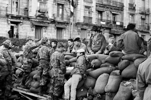 Soldiers from Territorial Units (UT) and paratroopers wait on the barricades erected during the insurrection of Algiers during the Algerian war [JEAN-CLAUDE COMBRISSON, STF / AFP via Getty Images]
