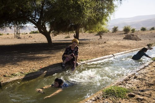 Jewish Israeli family hang out in the water of the natural spring of Ein Al-AUJA in the Jordan Valley West Bank on June 24, 2020 in Ein Al -Auja, West Bank. Israeli Prime Minister Benjamin Netanyahu's plan, which has drawn international reproval, would entail applying Israeli sovereignty to parts of the West Bank including Jewish settlements, as well as most of the Jordan Valley [Amir Levy/Getty Images]