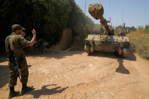 An Israeli soldier directs a self-propelled howitzer near Moshav Sde Eliezer, in northern Israel by the border with Lebanon on July 26, 2020 [JALAA MAREY/AFP via Getty Images]