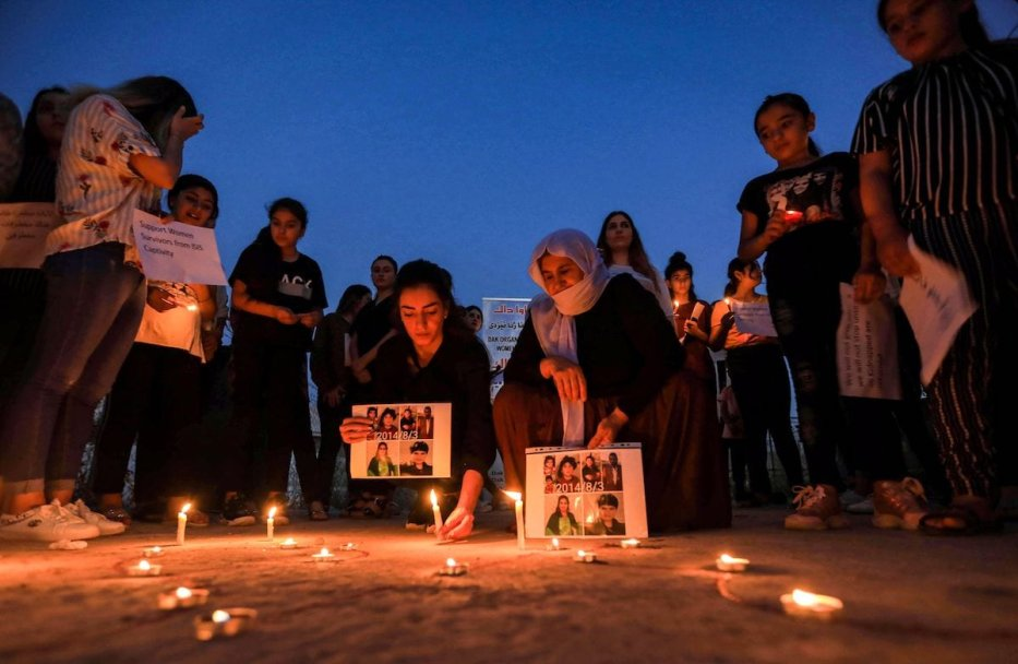 Iraqi Yazidis attend a candle-lit vigil in the Sharya area, in Iraqi Kurdistan region on August 3, 2020 [SAFIN HAMED/AFP via Getty Images]