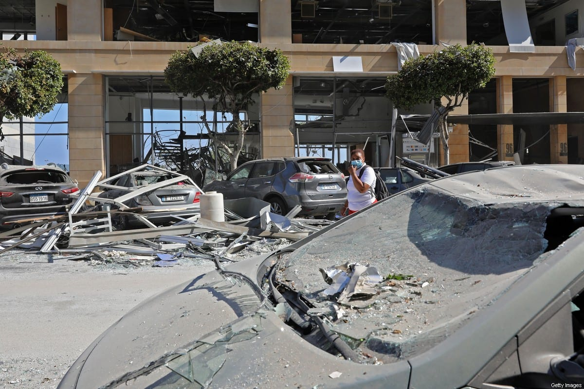Damaged vehicles and buildings are pictured in the aftermath of yesterday's blast that tore through Lebanon's capital and resulted from the ignition of a huge depot of ammonium nitrate at Beirut's port, on 5 August 2020. [ANWAR AMRO/AFP via Getty Images]