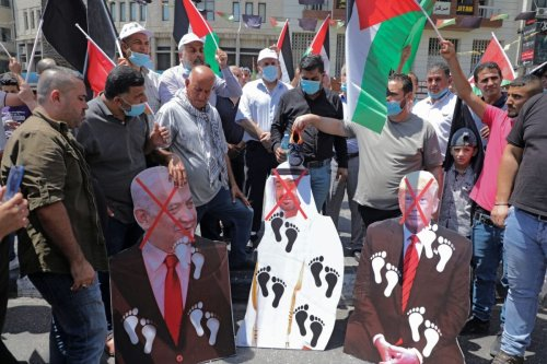 Palestinian protesters prepare to set aflame cut-outs showing the faces of (L to R) Israeli Prime Minister Benjamin Netanyahu, Abu Dhabi Crown Prince Sheikh Mohammed bin Zayed al-Nahyan, and US President Donald Trump, during a demonstration in Nablus in the occupied West Bank on August 14, 2020 against a US-brokered Israel-UAE deal to normalise relations [JAAFAR ASHTIYEH/AFP via Getty Images]
