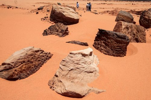 Remains of the two millenia-old site of Jabal Maragha that was ravaged by gold hunters in the desert of Bayouda, some 270 kms north of Khartoum on August 20, 2020 [EBRAHIM HAMID/AFP via Getty Images]
