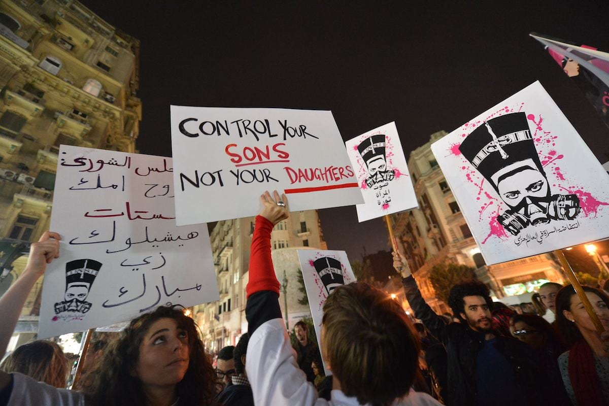 Egyptian protesters hold up placards and shout slogans during a demonstration in Cairo against sexual harassment on 12 February, 2013 [KHALED DESOUKI/AFP via Getty Images]