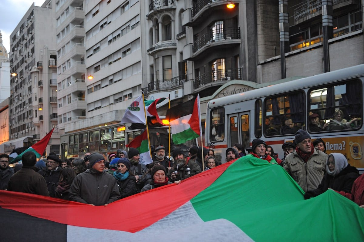 Pro-Palestinian demonstrators march along Montevideo's main avenue on 12 August 2014. [MIGUEL ROJO/AFP via Getty Images]