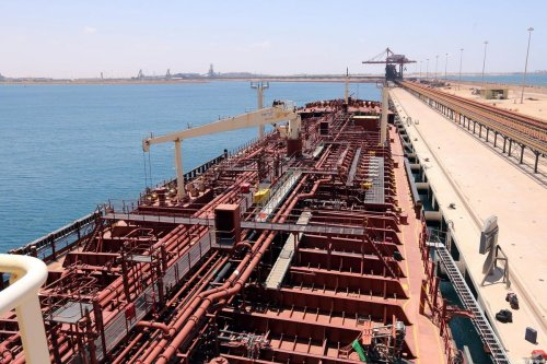 A picture taken on May 28, 2015 in the eastern port city of Misrata shows the oil tanker Anwar Afriqya moored at the harbour for maintenance, four days after it was hit by an air strike of the forces loyal to Libya's internationally recognised government off the coast near the city of Sirte. The vessel, transporting a light load of fuel from Greece, was hit while delivering its cargo to a power plant run by the rival administration. AFP PHOTO / MAHMUD TURKIA (Photo credit should read MAHMUD TURKIA/AFP via Getty Images)