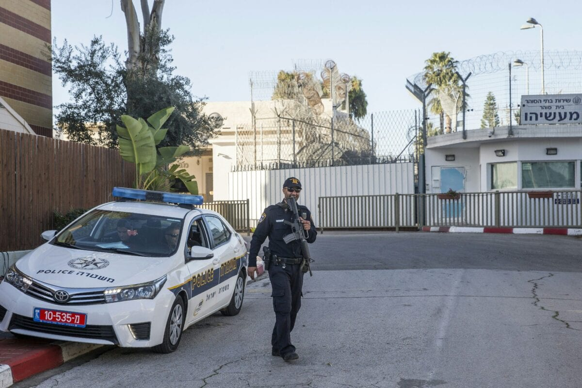 Israeli police officers stand guard on February 15, 2016 outside Maasiyahu Prison in the central Israeli city of Ramle [JACK GUEZ/AFP via Getty Images]