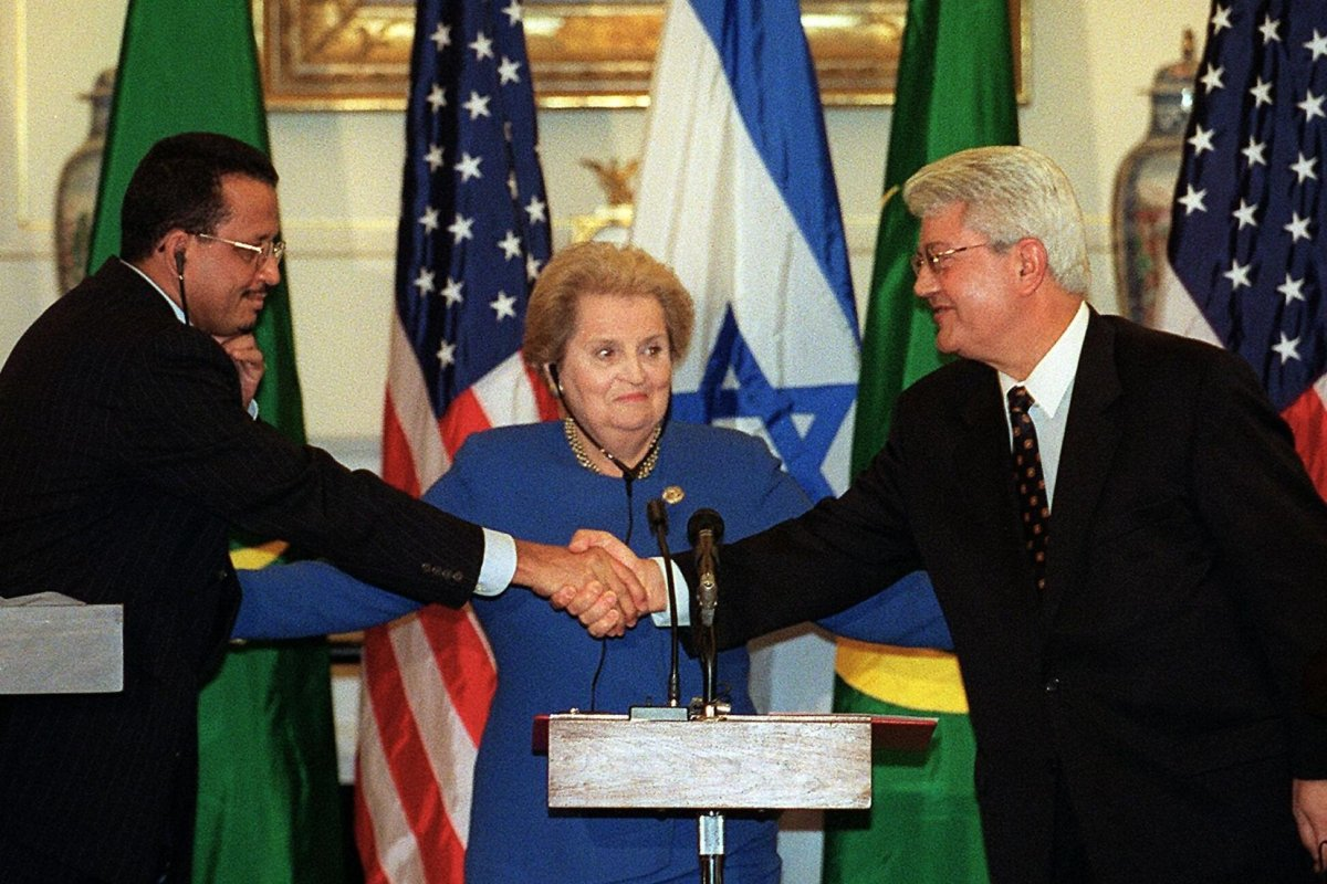 The then US Secretary of State Madeleine Albright(C), looks on as Israeli Foreign Minister David Levy(R) and Ahmed Ould Sid Ahmed(L), minister of Foreign Affairs for the Islamic Republic of Mauritania, shake hands after signing ceremonies 28 October, 1999 at the US State Department in Washington, DC [TIM SLOAN/AFP via Getty Image]
