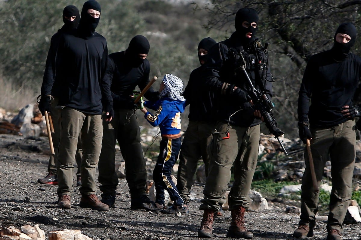 Masked members of the Israeli security forces briefly detain a Palestinian boy during clashes following a demonstration against the expropriation of Palestinian land by Israel in the village of Kfar Qaddum, near Nablus, in the occupied West Bank on 23 December 2016. [JAAFAR ASHTIYEH/AFP via Getty Images]