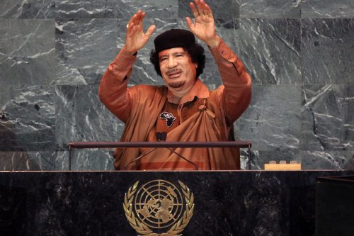 Libyan leader Col. Muammar Gaddafi waves before delivering an address to the United Nations General Assembly at UN headquarters on 23 September 2009 in New York City. [Mario Tama/Getty Images]