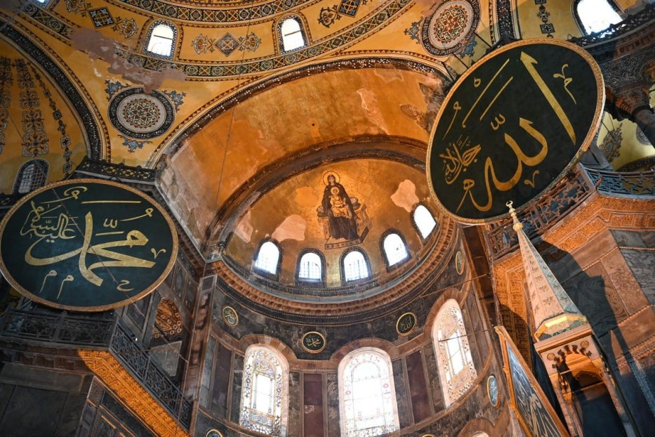 This picture taken on July 2, 2020 shows the Virgin Mary and child fresco and a calligraphic Roundels with Arabic letters bearing the name of Allah and other Muslim prophets hanging on the dome of the Hagia Sophia museum, in Istanbul, Turkey [OZAN KOSE/AFP/Getty Images]