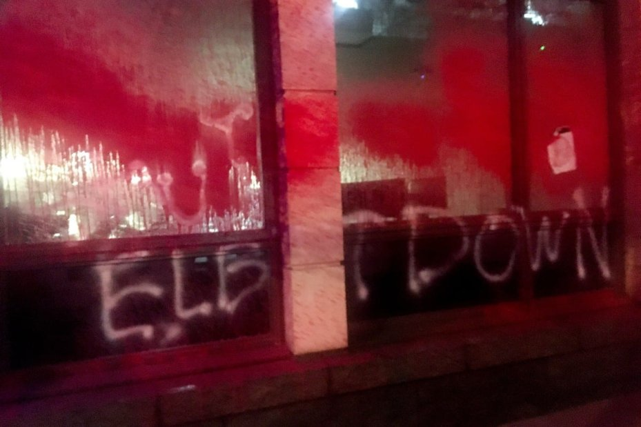 A building sprayed red, symbolising the blood of Palestinians, by Palestine Action activists in protest against Elbit Systems in London, UK [alestine Action]