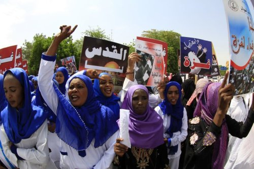 Sudanese protesters shout slogans during a rally to denounce Israel's treatment of Palestinians on 11 August 2014 in Khartoum, Sudan [ASHRAF SHAZLY/AFP/Getty Images]