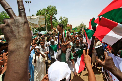 Sudanese protesters chant slogans during a sit-in outside the army headquarters in the capital Khartoum on May 1, 2019 [Getty]