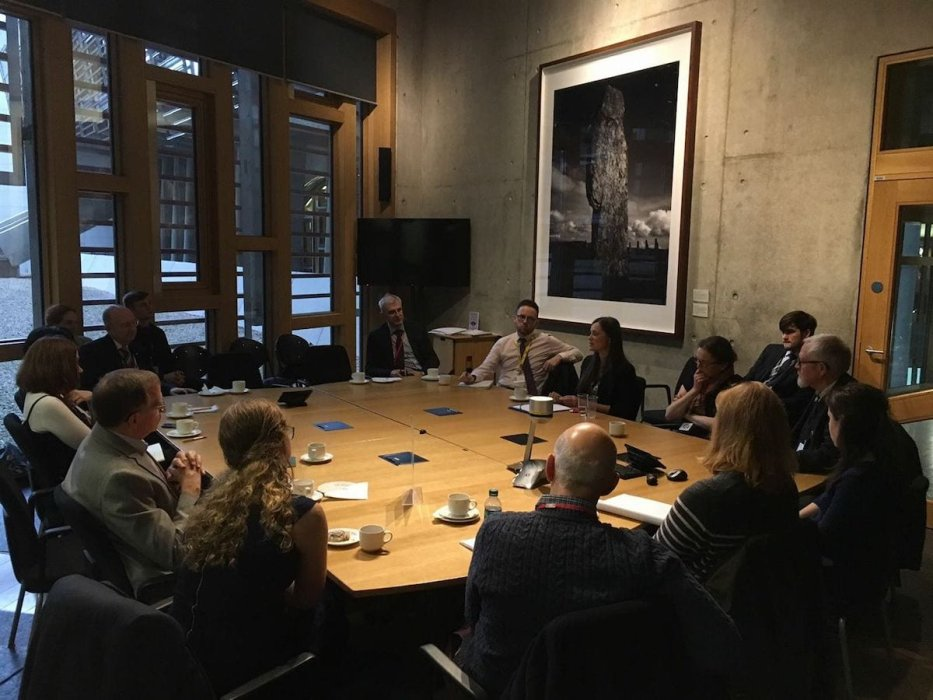 Kadletz speaking to members of the Scottish Parliament in Edinburgh in February 2017 about the situation of refugees [Burna Kadletz/Middle East Monitor]
