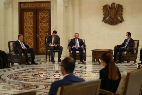 Russia's Foreign Minister Sergei Lavrov (L) and Deputy Prime Minister of Russia, Yury Borisov (3rd L) meet with Syrian leader Bashar al-Assad (Rear R) in Damascus, Syria on 7 September 2020. [Russian Foreign Ministry / Handout - Anadolu Agency]