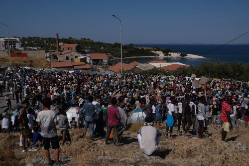 Refugees and migrants from the Moria camp protest the living conditions in the camp as they become homeless after a fire destroyed the Moria refugee camp on the Greek island of Lesbos in Greece on 11 September 2020. [Aggelos Barai - Anadolu Agency]