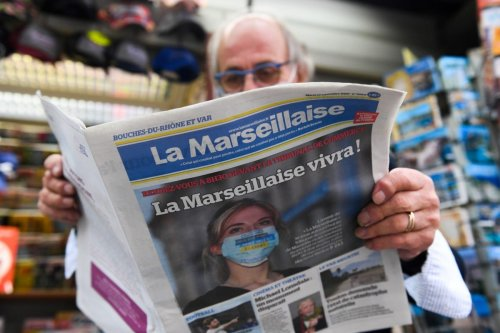 A man reads a local newspaper in Marseille, France on 22 September 2020 [NICOLAS TUCAT/AFP/Getty Images]