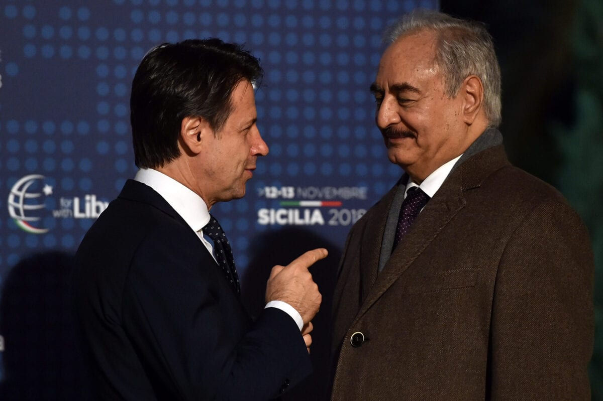 Italian Prime Minister Giuseppe Conte welcomes General Khalifa Haftar during tha Conference for Libya at Villa Igiea on November 12, 2018 in Palermo, Italy. [Tullio Puglia/Getty Images]