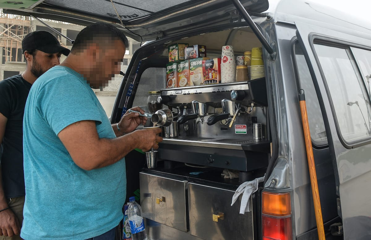 A Syrian refugee prepares coffee at the back of an improvised food truck in the Egyptian capital Cairo on 23 October 2018. [MOHAMED EL-SHAHED/AFP via Getty Images]