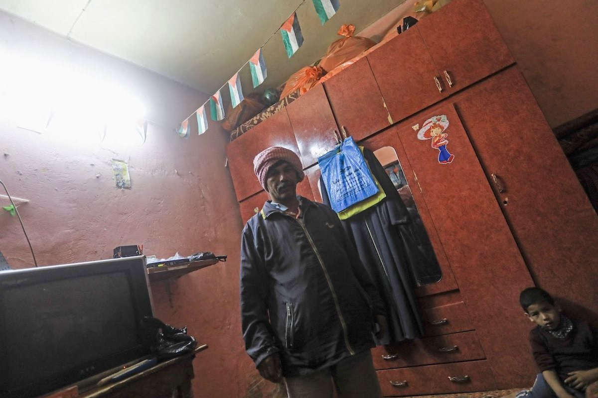 Unemployed Palestinian Salah Jibril, 47, stands in a room at a cramped two-bedroom flat on the outskirts of Gaza City, on 18 April 2020. [MAHMUD HAMS/AFP via Getty Images]