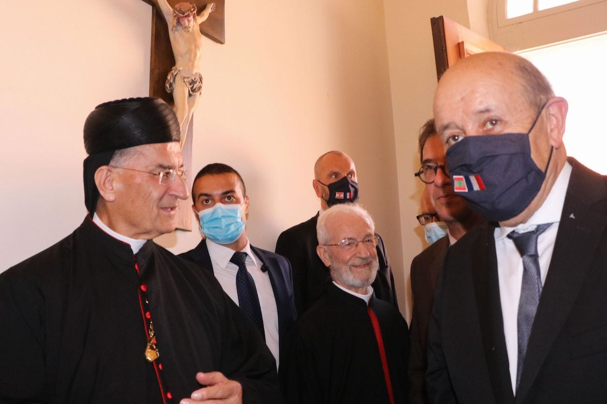 Lebanon's Christian Maronite patriarch Beshara Rai (L) welcomes France's Foreign Minister Jean-Yves Le Drian in Bekerke north of Beirut on 23 July 2020. [AFP via Getty Images]