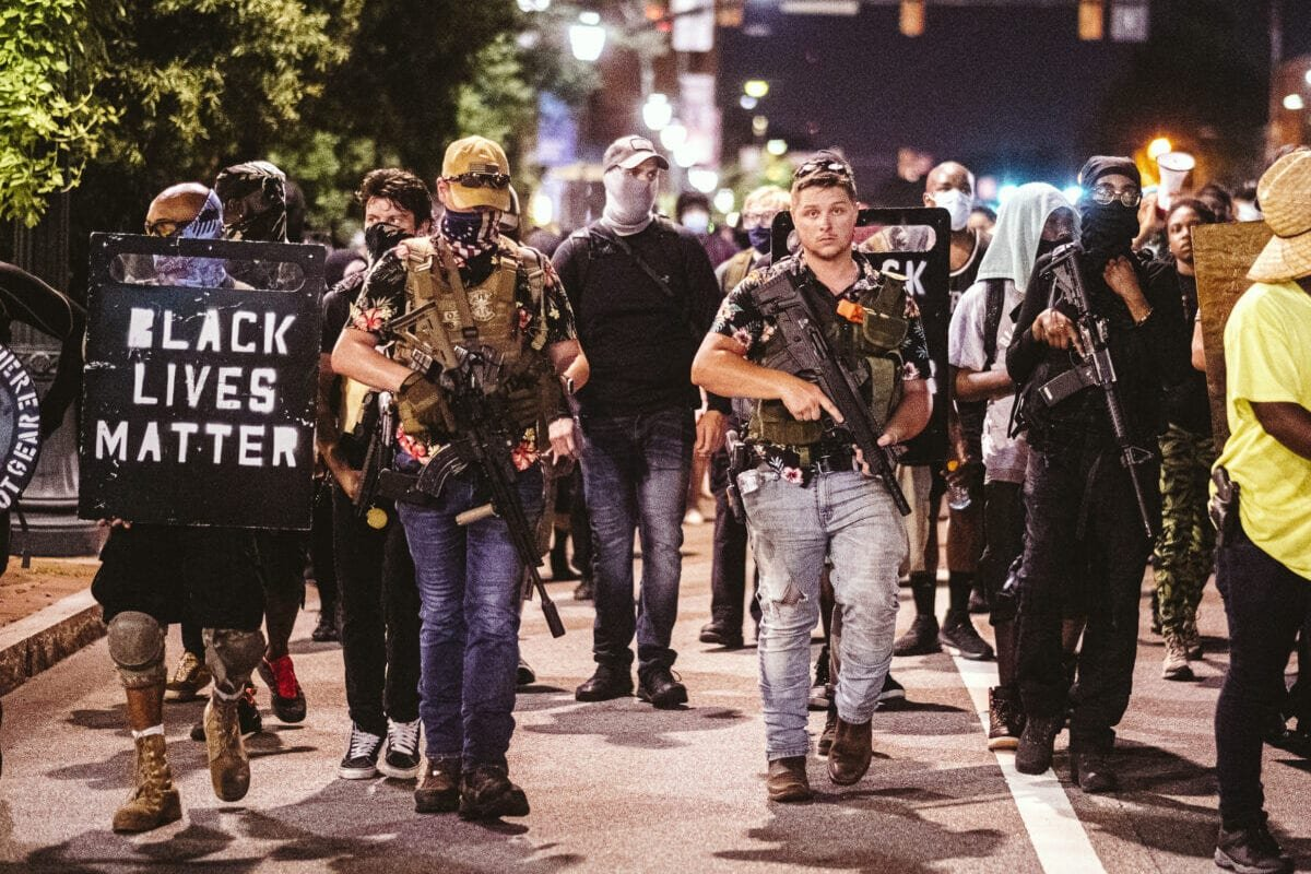Armed members of the Boogaloo Bois march with Black Lives Matter protesters on July 25, 2020 in Richmond, Virginia [Eze Amos/Getty Images]