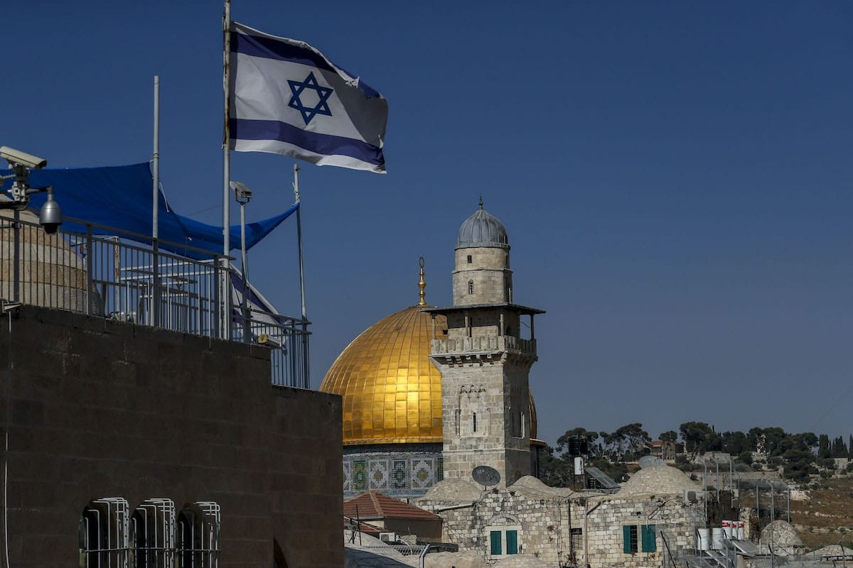 An Israeli flag flies in front of the Dome of the Rock mosque near the al-Aqsa mosque compound in Jerusalem's Old City, on 24 August 2020. [AHMAD GHARABLI/AFP via Getty Images]